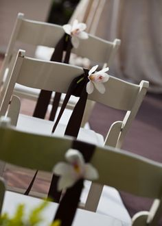 Simple idea for decorating plain chairs at a wedding ceremony, when on a budget, only do the aisle chairs