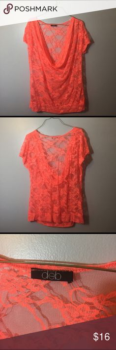 #28 neon orange lace top This cowl neck lace top doesn't have a size tag but I am going to say compared to the other Deb tops I have, it is a 2X. It doesn't really have much stretch to it, but it fit me at a size 18/20. It looks great paired with a black cami and jeans. White would also work well. This shirt is NEON orange though, the pictures don't quite do it justice. Deb Tops Blouses