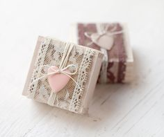 super cute packaging idea. strip of lace, long bits of string and a little charm tied on with a bow. I like this for wrapping favors....maybe homemade soaps or something.