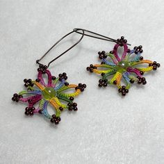 "Tatted Lace ""Clarissa"" Earrings in Garden Afternoon. Espresso seed beads and olive translucent center beads were worked into the lace using Garden Afternoon thread hand dyed by Yarnplayer."