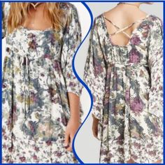 Free People Soft Floral Dress Lovely pink & purple floral tunic dress. Wear alone or with leggings. EUC only worn twice! Dry cleaned both times. Sized small yet really roomy and can be worn by med. Free People Dresses Mini
