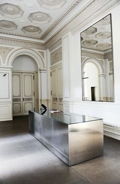In the foyer of her design headquarters, a polished console by Gabellini, with whom she also collaborated on her stores (Photograph by Jil Sander)