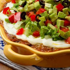 Hosting a Super Bowl party? Here are 5 ways to keep it healthy. Recipe pictured: Southwestern Layered Bean Dip