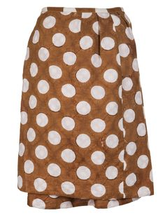 Dotted wrap skirt in gobo from Dosa. This straight cotton skirt features a large white dotted print throughout, light pleating, and a short length hem. Has a wrap-style construction with belt loops and a self-tie at the side.