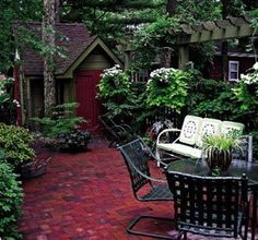 love all the greenery & the brick & especially the old glider