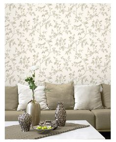 This beautiful wallpaper features an intricate design of delicate tree branches with leaves, flowers and beautiful birds in gold on a pale cream background. Also comes in duck egg.