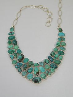 I don't normally care for turquoise, but this piece is lovely! Please look at some intersting etsy shops energywire.etsy.com - wier jewellery. Elitalshop.etsy.com - fashion jewellery. Justbelievebybelinda.etsy.com Personaziled jewellery.