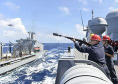 Petty Officer 2nd Class Wayne Moore fires the shot line to the Military Sealift Command (MSC) fleet replenishment oiler USNS Guadalupe (T-AO 200) to begin an underway replenishment aboard the amphibious transport dock ship USS Somerset (LPD 25).