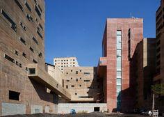 Praça das Artes by Brasil Arquitetura features concrete boxes projecting over a public plaza