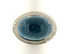 18K white gold ring featuring a 24.06 ct. Aquamarine cabochon accented with pave-set Diamonds (.35 ctw.).