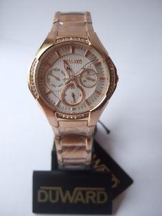 Reloj de señora en tono rosa.