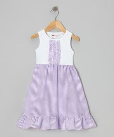 Ruffles galore show off the girly side of things when little lasses sport this over-the-head style. Featuring a knit bodice and seersucker skirt, its washable cotton construction keeps things looking fresh for repeat wearing.