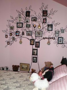 Paint a tree on your wall and put pictures on your wall ( make your tree the same color as your picture frames)
