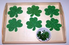 One to One Shamrock Match  Place one small shamrock from the bowl onto each larger shamrock.  ~one to one correspondence~