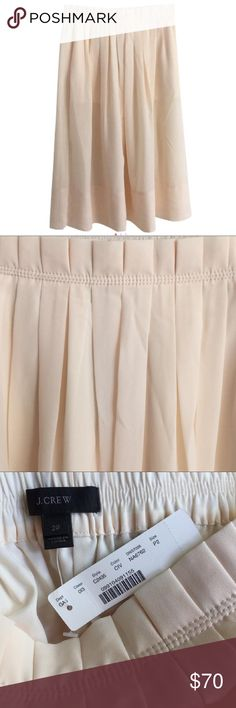 J.Crew Midi Skirt in Cream Pull-on elastic skirt with paper-bag waist in cream from J.Crew. NWT. Size 2P. Lined with elastic waistband. Slit pockets. Midi length. Falls below knee. 100% polyester. J. Crew Skirts Midi