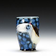 Bernadette Curran. Thrown and altered  porcelain cup with slip and glaze.