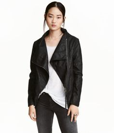 87df359a455 Biker jacket in imitation leather. Diagonal zip at front, ribbed jersey  sections under arms