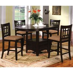 Conveniently expandable, this unique counter height set offers a round table that transforms into an oval shape while providing a handy display shelf right below. The chairs are super comfortable and inviting with padded microfiber cushioning.
