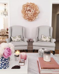 That flower wreath on the wall is fabulous!