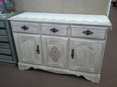 $125 - This maple buffet has 1 long divided drawer and double door cabinet below.  It has been painted a creamy white, distressed and finished with a dark tinted wax.  New pot metal hardware and stincel detail finish the shabby chic look. It measures approximately 48 inches across the front by 17 inches deep and stands 32 inches tall. It can be seen in booth A8 at Main Street Antique Mall 7260 East Main Street ( E of Power Rd ) Mesa,  AZ 85207 480 9241122open 7 days a week 10a....