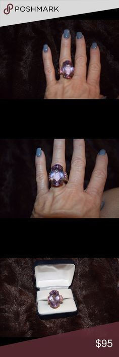 Sterling silver with 14 k highlights. Very heavy ring 925/14k. I believe the stone is pink tourmaline. Very eye catching large stone. Jewelry Rings