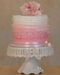 Ombre Ruffle cake with sugar peony topper. This 8-inch double height ombre ruffle cake has ombre sponge cake layers on the inside to match the graduation in colour on the outside. Cake inspired by Maggie Austin.