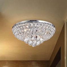 Add elegance to any setting with this stunning light fixture, accented with crystals. The chrome finish adds a finishing touch.
