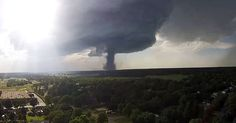 Amazing photos, drone video show tornado touchdown in Kansas on July 13, 2015.