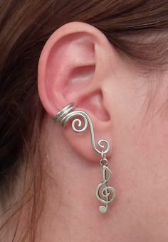 Double Spiral Ear cuff with treble clef in wire wrapped aluminium. (wire wrapping aluminum) Choose your color of aluminium..