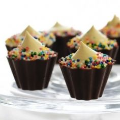 Chocolate cupcake molds filled with vodka-cake-pudding.  (Whoa...really...mmm...sounds yummy!)