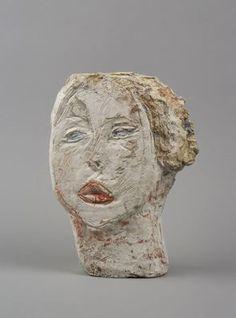 Tête de femme (Flora Mayo)  Date de création 1926  Technique Plâtre peint retravaillé au canif  Dimensions 31,2 x 23,2 x 8,4 cm