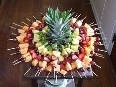 Fruit Skewers stuck in a pineapple ... awesome appetizer centerpiece