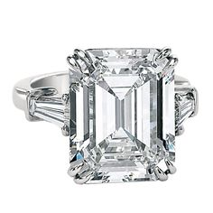 An Important 10.02ct Emerald Cut Diamond GIA Cert Ring by David Rosenberg.    This handmade Platinum ring is set with a 10.02 Emerald cut G/VVS2 accompanied with a GIA cert # 16915465.    Flanked by a matching pair of 1.00tw tapered Baguettes.