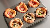 Everyday Food editor Sarah Carey shows you how to bake up fun, individual pizzas. Get the kids to help!