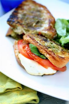 Grilled smoked mozzarella and basil pesto sandwich from the curvy carrot, only my FAVORITE veggie recipe blog...not to mention she's a great writer and hilarious to boot. (=
