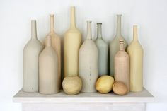 'Mundane' - ceramic still life consists of nine bottle forms and three fruit. All pieces are made of low fire clay, completely hand sculpted by using very thin slabs. No molds have been utilized in the process. The pieces have been treated with underglazes, engobes, glaze and oxide washes in a subtle, layered way.