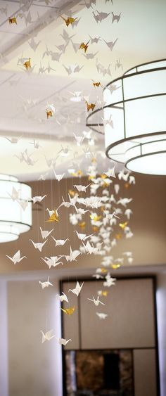 Love cranes. This installation is simple but symbolic. They symbolize togetherness, longevity, love. Incorporate paper cranes into arrangements?