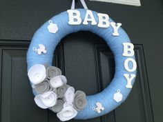 """Baby Boy Yarn Wreath 14 inches White and by TheCreativeTeacher, $22.00  Replace """"baby boy"""" with his name."""