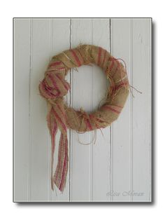 Beautiful, rustic, burlap wreath for pink lovers.