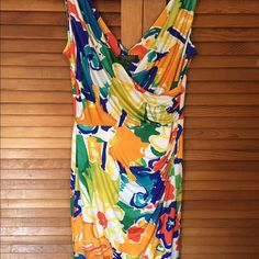 NWOT Floral Ralph Lauren dress size 10 Perfect for warmer weather multi color dress. Fabrics has some stretch. Never worn Ralph Lauren Dresses
