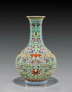 Finely enameled, Chinese turquoise ground Famille Rose enameled porcelain vase; of bottle form, with Buddhist design of coral red bats; Daoguang seal mark but probably Republic Period; H: 12 1/2""