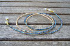 Brillenkette blau gold von Unbehauen - Schmuckdesign auf DaWanda.com