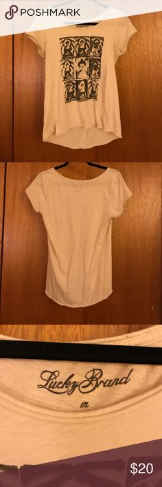 Lucky Brand Buddha Tee This cute cream colored tee with a Buddha design on the front from Lucky Brand is in excellent used condition! Soft and comfy with a slightly longer back than front; great with leggings! Lucky Brand Tops Tees - Short Sleeve