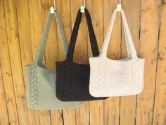An easy tote with braided cables that continue into the handles. A perfect first cable or felting project.