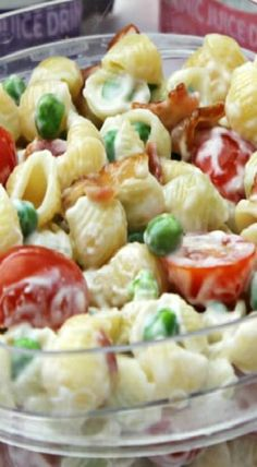 pasta salad with bacon, peas and tomatos