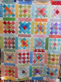 Made from all different Moda collections and mini charms. 2.5 squares. Just like candy. Love them.