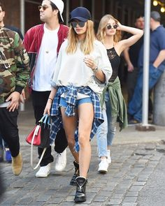 Hailey Baldwin is ahead of the trend as usual in a pair of utility boots while out with friends in the city