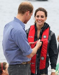 Prince William, Duke of Cambridge and Catherine, Duchess of Cambridge arrive on shore after rowing dragon boats across Dalvay lake on July 4, 2011 in Charlottetown, Canada.