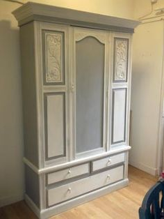 Wardrobe painted in Annie Sloan Chalk Paint in Paris Grey and Old White finished in Annie Sloan Clea from our Buy bunting collection