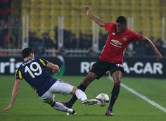 Marcus Rashford of Manchester United in action with Sener Ozbayrakli of Fenerbahce during the UEFA Europa League match between Manchester United and...